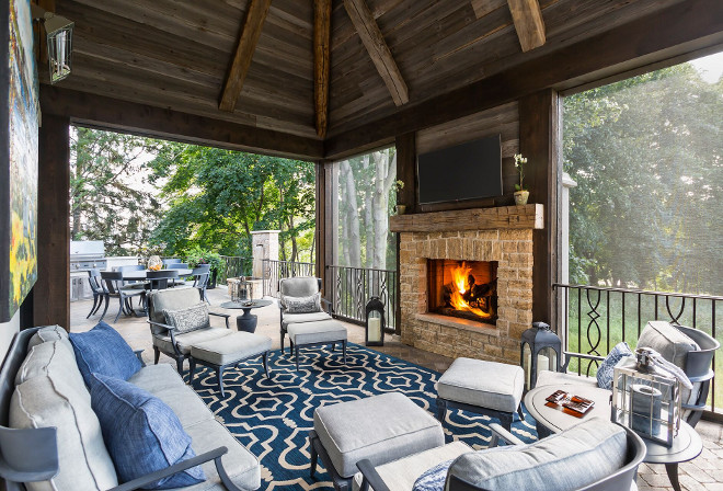 Screened in porch. Screened in porch. Screened in porch with fireplace and reclaimed wood ceiling. Screened in porch. #Screenedinporch #fireplace #reclaimedwoodceiling #reclaiedwood screened-in-porch Hendel Homes