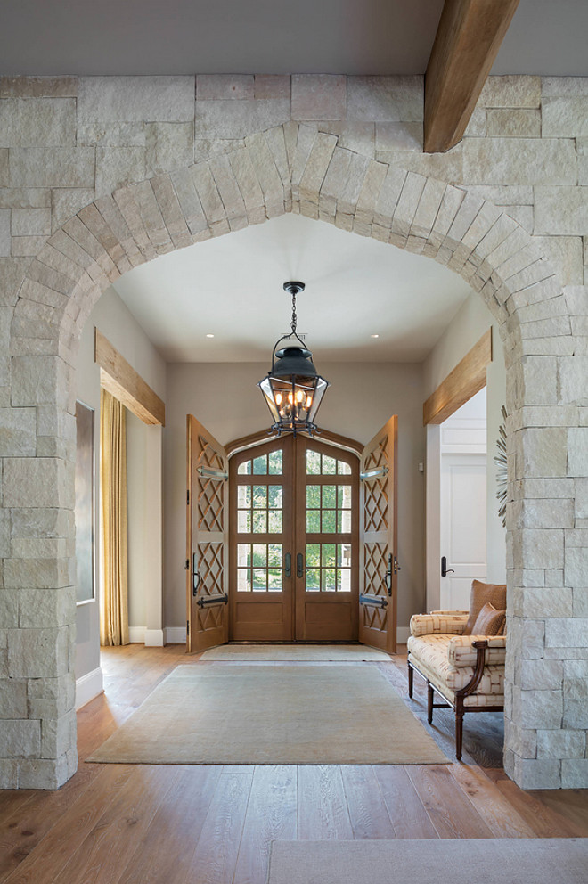 "Stone Archway. Foyer with stone archway. The foyer features a timeless stone archway. The stone was purchased from Alamo Stone and is called ""White Chopped"" stone. #Stonearchway #stone #archway #whitechoppedstone #choppedstone Allan Edwards Builder Inc"