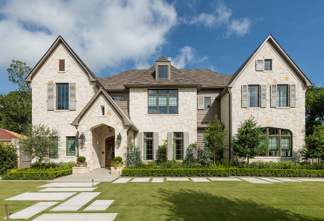 Stone home. Stone home ideas. The exterior of this home features beautiful natural stone and grey shutters. #stonehomes #stoneexterior #greyshutters Allan Edwards Builder Inc