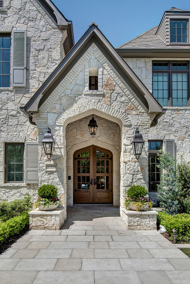 "Exteriro stone. The exterior stone is a full 4"" limestone quarried in Oklahoma, sold locally by Alamo Stone. Their in-house name is Alamo White Ledgestone. #exteriorstone #exterior #stone Allan Edwards Builder Incstone-exterior-with-wood-front-door"
