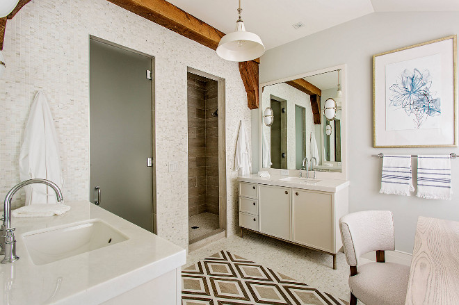 Transitional bathroom. There's nothing boring about this bathroom. I love the barn pendant light, the beam accent and the floor tile. #transitionalbathroom #bathroom #tile #barnpendantlight #light #beam Herlong & Associates Architects + Interiors