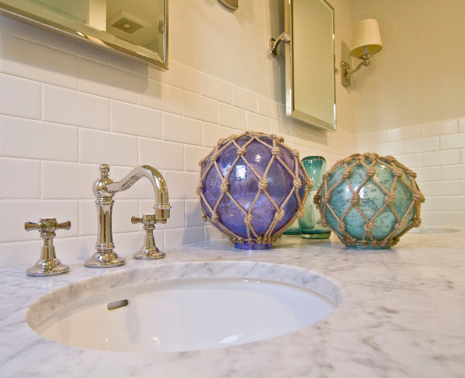 Glass Buoys. Glass buoys add some color and a coastal feel to this guest bathroom. Glass Buoys. vanity-decor Glass Buoys #GlassBuoys Home Bunch Beautiful Homes of Instagram Bryan Shap @realbryansharp