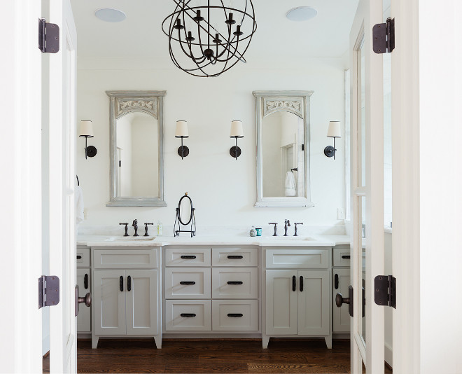 White bathroom with grey vanity. White bathroom with grey vanity and rubbed oil bronze hardware and lighting. #Whitebathroom #greyvanity #rubbedoilbronze  #rubbedoilbronzehardware #rubbedoilbronzelighting white-bathroom-with-grey-vanity Willow Homes