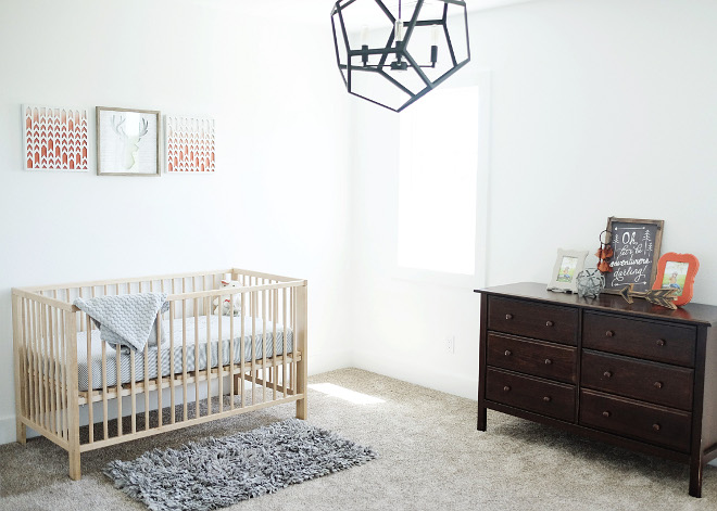 Transitional nursery. For this room, I wanted it to be more outdoorsy with different tones of brown, a few gray tones, and accents of orange. Paint color is Sherwin Williams Extra White. Crib is Ikea and the light fixture is RH Baby & Child. Beautiful Homes of Instagram @nc_homedesign via Home Bunch