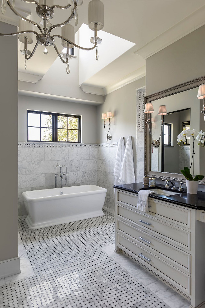 French Bathroom. This elegant French grey bathroom features custom vanity with soapstone countertop and marble basketweave floor tiles. #Frenchbathroom #Frenchinteriors #bathroom Hendel Homes
