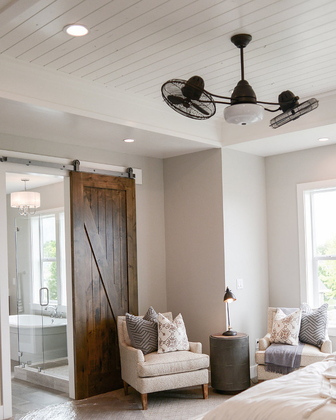 Master Bedroom barn door. A walnut-stained barn door opens to the master bathroom. #masterbedroombarndoor #barndoor Millhaven Homes