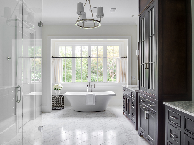 Serene bathroom. The master bathroom is serene and bright, just like every other space in this home. Countertops are calacutta. Tub is Escale by Kohler. #bathroom #serenebathroom Interiors by Courtney Dickey. Architecture by T.S. Adam Studio.