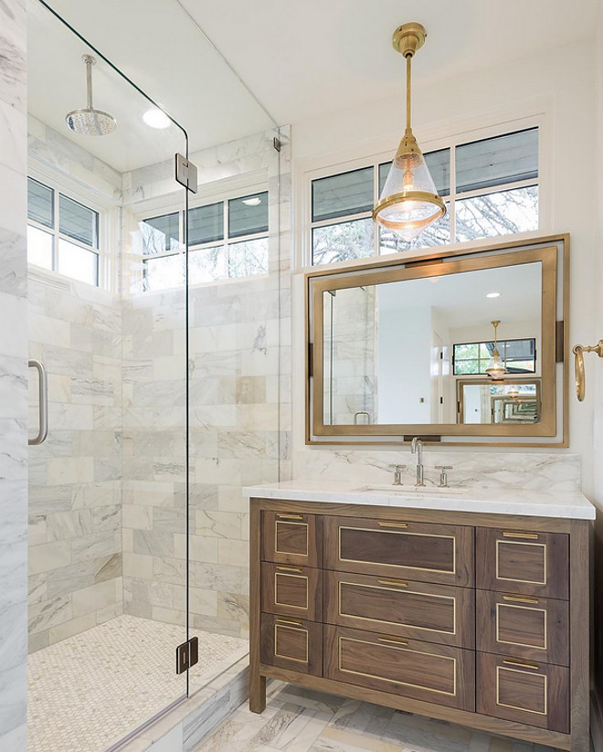 Bathroom Cabinet. Bathroom cabinet is a dark walnut with brass inlay. Bathroom floor tile is Calcutta marble. Cabinetry stain is a dark walnut with brass inlay. The plumbing fixtures are Kohler Purist. Light fixtures are Visual Comfort. #bathroom