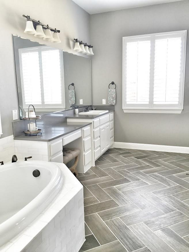 My master bathroom was the hardest area for me to design. I really loved these gray wood looking tiles in a herringbone pattern for the floors. Bathroom tile floor is Daltile EMSLEM EM03 Gray 7x20 laid Herringbone with #386 Oyster Gray grout.