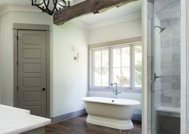 Bathroom with pale gray walls and grey trim and grey door. Bathroom with pale gray walls and grey trim and grey door ideas. #Bathroom #palegraywalls #greytrim #greydoor bathroom Willow Homes