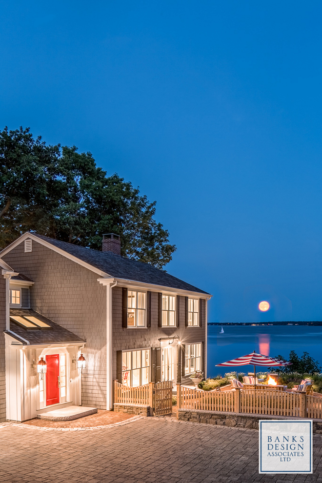 Beach house. Shingle beach house with red door. Red door paint color specified on the blog Home Bunch. #shinglebeachhouse #shinglehouse #reddoor #redfrontdoor #paintcolor Banks Design Associates, LTD & Simply Home