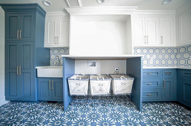 Blue and white laundry room. Blue and white laundry room tile. Blue and white laundry room cabinet. Blue and white laundry room paint color #Blueandwhitelaundryroom #Blueandwhite #laundryroom #Blueandwhitelaundryroomtile #Blueandwhitelaundryroompaintcolor #Blueandwhitelaundryroomcabinet Builder: Millhaven Homes. Interior: Four Chairs Design