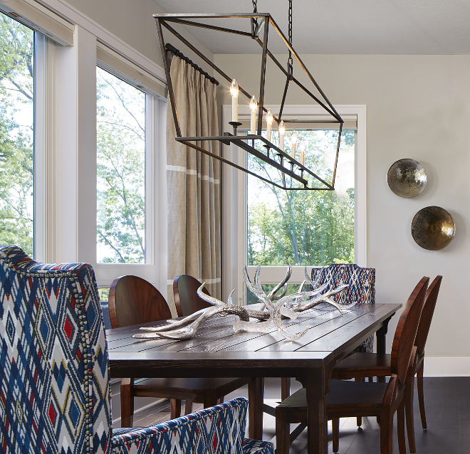Darlana Linear Pendant CHC2166 in Aged Iron. Beautifully decorated, this dining room feature floor-to-ceiling windows and a liner chandelier over the table. Linear chandelier is Darlana Linear Pendant CHC2166 in Aged Iron #DarlanaLinearPendant #DarlanaLinearPendant CHC2166 #AgedIron#DarlanaLinearPendant Vivid Interior Design