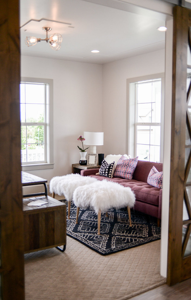 Home Office. The barn doors open to a cozy home office. Lighting is Scout 3 Light Adjustable Semi-Flush. #homeoffice #lighting Millhaven Homes