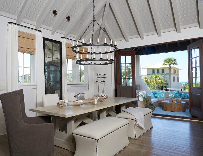 Dining room. Open to outdoors dining room. A wall of bifold doors connects the indoors to the outdoors, allowing plenty of ocean breeze in. #dininroom #opnediningroom #biforlddoors dining-room