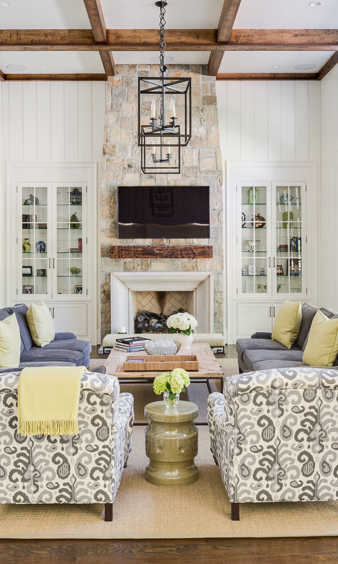 Stone Fireplace. The fireplace uses the same stone as used on the exterior of the house with a limestone surround. Stone fireplace #StoneFireplace Interiors by Courtney Dickey. Architecture by T.S. Adam Studio.