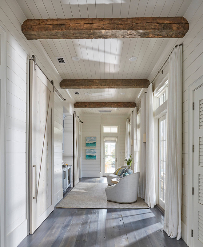 Floor To Ceiling Shiplap Paneling With Reclained Wood Beam This Hallway Boasts Rustic