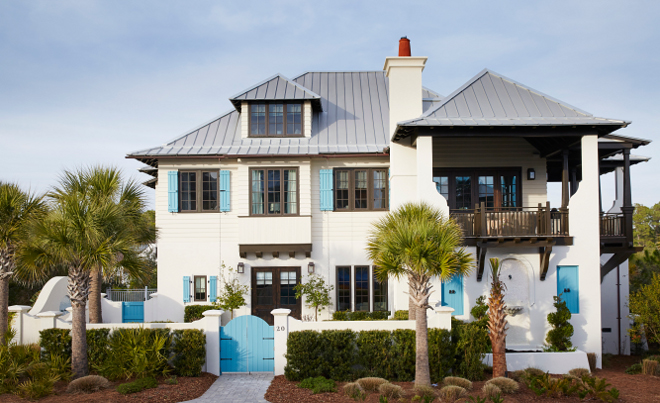 Floida beach house. The exterior of the house mixes traditional West Indies with coastal architectural details. Dark steel windows paint color is Espresso Beans PPU5-01 Behr. florida-beach-house