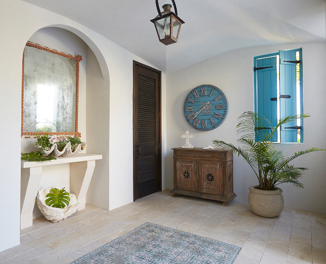 Outdoor foyer. Beach house with outdoor foyer. The outdoor foyer features an antique mirror and a built-in cast-concrete console. #outdoorfoyer #foyer