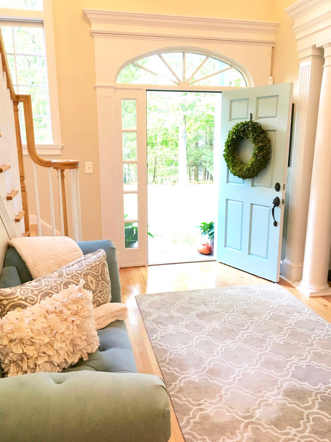 Blue front door. A blue front door opens to a bright, two-storey foyer. Blue door front door paint color is Benjamin Moore 723 Spring Rain. #BenjaminMoore723SpringRain #BenjaminMoore723 #BenjaminMooreSpringRain #Bluedoor #bluefrontdoor Beautiful Homes of Instagram peonypartydesigns
