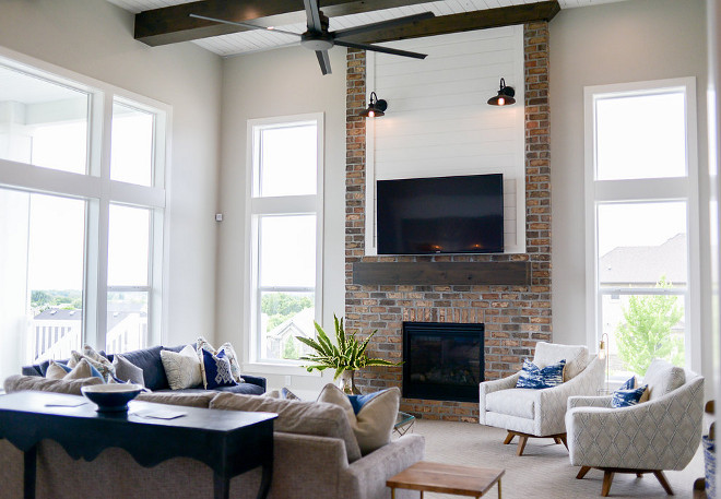 High Ceiling family room. A family room with high ceilings and with floor-to-ceiling windows is located just of the kitchen area. #highceiling #familyroom Millhaven Homes