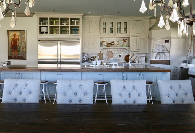 The cabinets feature custom doors and millwork with diamond pattern above doors and windows. Paint color is Benjamin Moore Revere Pewter. Home Bunch's Beautiful Homes of Instagram @artfulhomestead