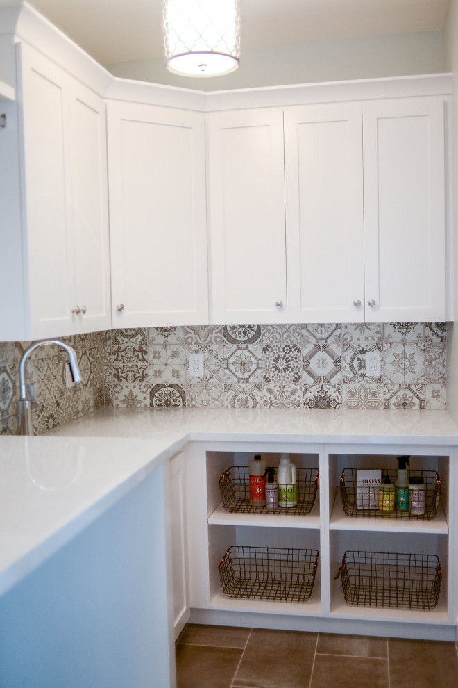 "It's great to add a little of personality in small spaces such as laundry rooms. This one features white quartz countertop and patterned cement tiles for backplash. Countertop is Lyskamm Quartz. Flooring: Reside 12x24 Ash Semi-polished, 12""x24"", brick layout. Laundry room paint color is General Paint Norquay CL 3081. Millhaven Homes"