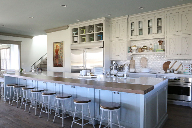 Long kitchen island. The family kitchen was designed to accommodate Hollie's entire family and it features a 20' table and 20' island. kitchen island 20' island. #kitchenisland #longkitchenisland #20'island long-kitchen-island Home Bunch's Beautiful Homes of Instagram @artfulhomestead