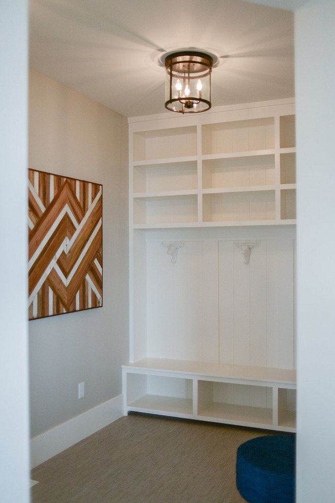 Mudroom Hooks. This mudroom features plenty of storage and some fun hooks! #mudroom #mudroomhooks #hooks Millhaven Homes