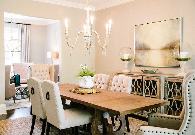Neutral dining room with sitting area. Located just off the dining room, this sitting area is perfect to relax after a long dinner with friends. #diningroom #sitttingarea #entertaining neutral-dining-room Outrageous Interiors