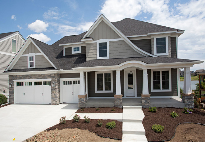 New Home Exterior Paint Color Ideas: The exterior colors on this house are all Sherwin Williams. Lap siding is Sherwin Williams SW7047 Porpoise. Shakes and Board & Batten are Sherwin Williams SW7045 Intellectual Gray. Trim is Sherwin Williams SW7005 Pure White. #newhomeexteriorpaintcolor #newhome #exteriorpaintcolor #paintcolor new-home-exterior-paint-color Homes by Tradition