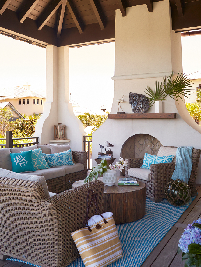 Porch. Porch fireplace and outdoor furniture. The second level features a wrapround porch with incredible Gulf views.