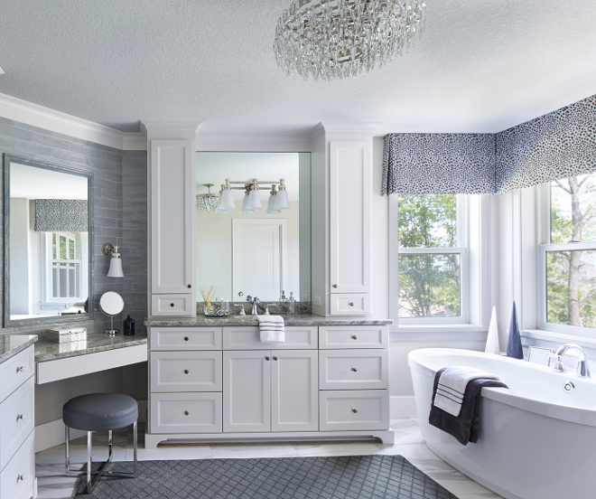 White bathroom Cabinet paint color SW7014 Eider White by Sherwin Williams. Great white paint color for cabinets. White bathroom Cabinet paint color SW7014 Eider White by Sherwin Williams. #whitecabinet #paintcolor #SW7014EiderWhite #SherwinWilliams Vivid Interior Design