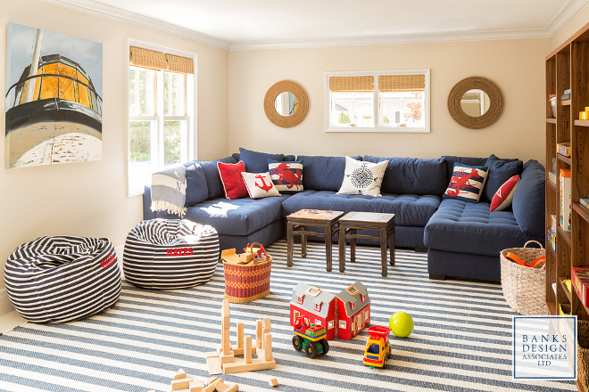 Nautical themed rooms. Located above the garage, this nautical playroom features classic coastal colors like navy, red and stripes. #nauticalthemed  Banks Design Associates, LTD & Simply Home