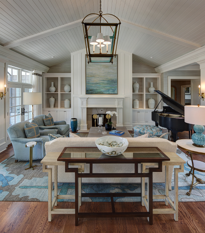 Shiplap vaulted ceiling. The living room design incorporates a shiplap ceiling and a relaxed lounge area with sophisticated accents in upholstery, lighting, and accessories. Layering breezy blues and crisp creams against classic English arm chairs and a textured chenille sofa, a casual elegance is brought to this space. #shiplap #vaulted #ceiling #shiplapceiling shiplap-vaulted-ceiling W Design