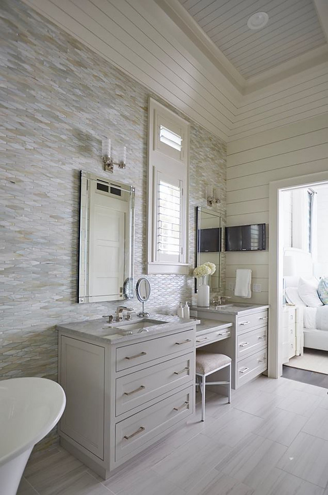 Oblong Marble Tile Wall. Bathroom features Oblong Marble Tile and shiplap walls. This master bathroom features an oblong marble tile accent wall, neutral floor tiles and light gray his and her washstands flanked by a drop down makeup vanity. Vanity paint color is similar to Benjamin Moore OC-52 Gray Owl. shiplap-bathroom-with-tile-accent-wall