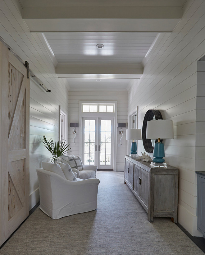Shiplap foyer with barn door. Foyer features shiplap walls, shiplap ceiling and sliding barn door. #shiplap #foyer #barndoor #shiplapfoyer #barndoor #foyerbarndoor shiplap-foyer-and-barn-door Geoff Chick & Associates