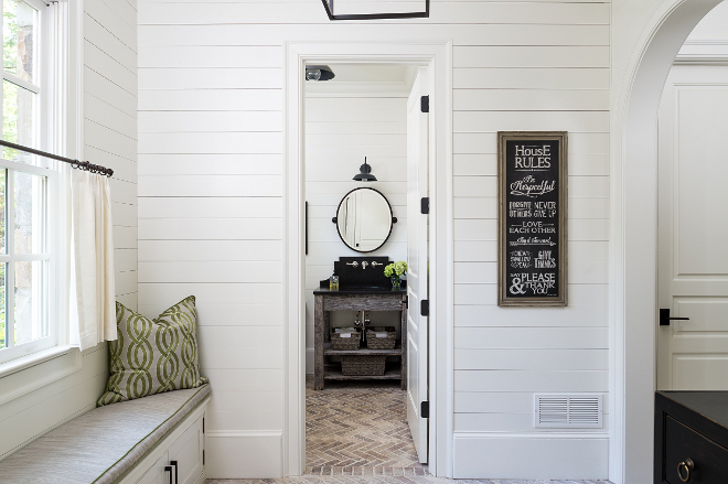 Farmhouse shiplap mudroom. Farmhouse mudroom. The mudroom features shiplap walls and a window seat. Cushion is in an indoor/ outdoor fabric. #shiplap #farmhouse #mudroom #farmhousemudroom shiplap-mudroom-with-bathroom Interiors by Courtney Dickey. Architecture by T.S. Adam Studio.