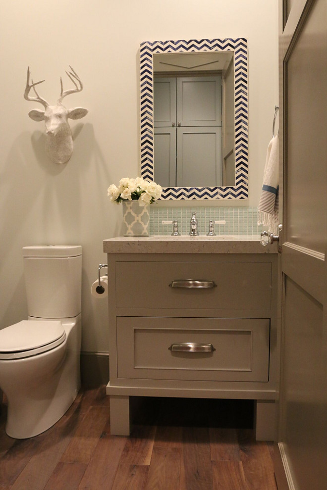 Small vanity. This small bathroom features hardwood flooring, a small vanity and a quartz countertop. small-vanity #smallbathroom #smallvanity #smallspaces Home Bunch's Beautiful Homes of Instagram @artfulhomestead