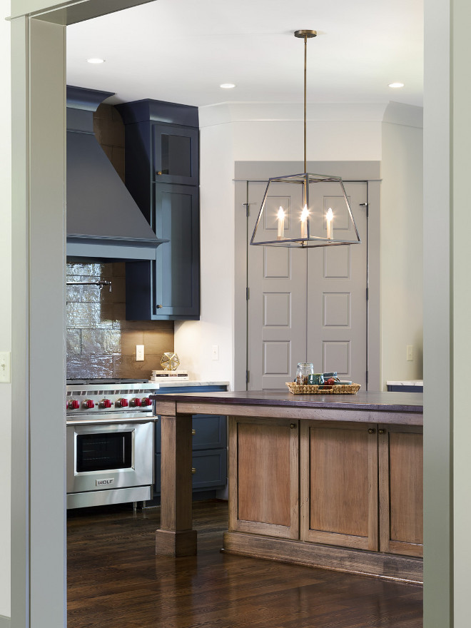The wall color is Agreeable Gray by Sherwin Williams and the pantry door is Dovetail by Sherwin Williams. Willow Homes