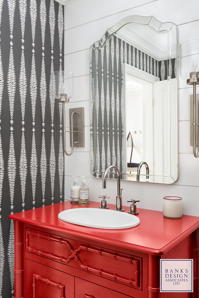 Heritage Red by Benjamin Moore. This powder room mixes elements in a very intriguing way - a hand-screened wallpaper in white and charcoal plays against shiplap accent wall while a red bamboo vanity carries the color palette of the house to this space. Red vanity paint color is paint color is Heritage Red by Benjamin Moore. #HeritageRedBenjaminMoore Banks Design Associates, LTD & Simply Home