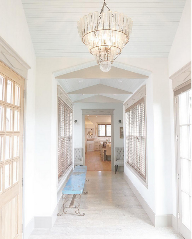 Blue ceiling paint color. The breezeway...going toward the family kitchen. Vintage soda bottle chandelier on pitched blue beadboard ceiling painted Sherwin Williams Copen Blue. Benches are from Anthropologie and sconces are from Restoration Hardware. blue beadboard ceiling painted Sherwin Williams Copen Blue #blue #beadboard #ceiling #blueceiling #paintcolor #SherwinWilliamsCopenBlue Home Bunch's Beautiful Homes of Instagram @artfulhomestead