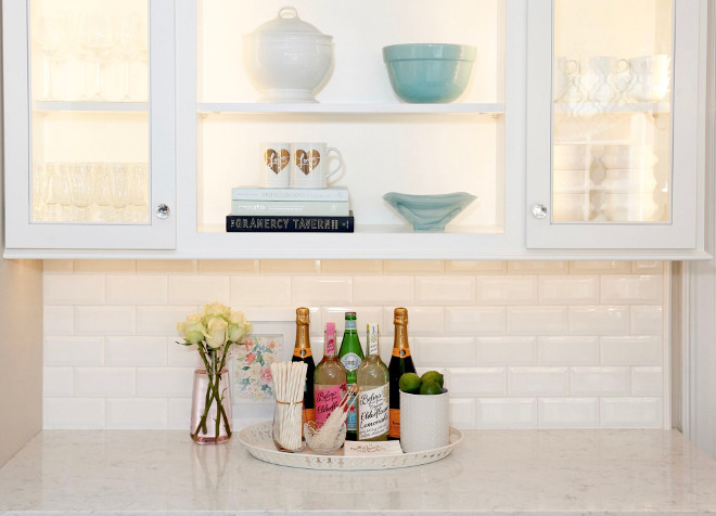 White wet bar. White wet bar cabinet, white tile backsplash and white marble looking quartz countertop. #Whitewetbar #wetbar Home Bunch's Beautiful Homes of Instagram peonypartydesigns