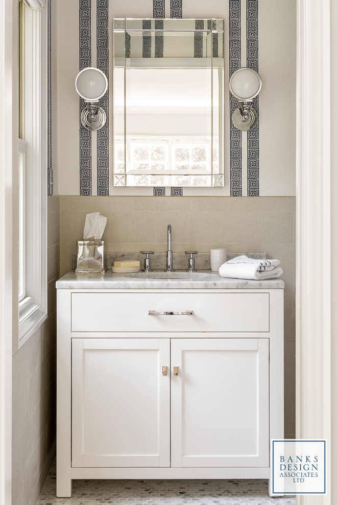 Small Bathroom. The homeowner and designer decided that every bedroom in the house would have its own bathroom, no matter how small it might be. This bathroom features a Greek-key wallpaper and a marble topped vanity painted in Benjamin Moore Decorator's White. Wall covering is Schumacher & Co. Greek Key Stripe in Navy. #smallbathroom #smallinteriors #bathroom #smallbathrooms Banks Design Associates, LTD & Simply Home