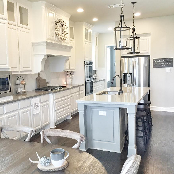 White farmhouse kitchen with soft grey island. White farmhouse kitchen. White farmhouse kitchen grey island. White farmhouse kitchen ideas #Whitefarmhousekitchen #farmhousekitchen #kitchen #farmhouse #greyisland Beautiful Homes of Instagram ceshome6