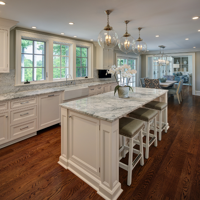 White kitchen countertop. This gorgeous kitchen features white marble countertop and backsplash. Wall paint color is Repose Grey by Sherwin Williams. #White kitchen with white marble countertop. #whitekitchen #whitemarble #countertop #marblecountertop white-kitchen-countertop W Design
