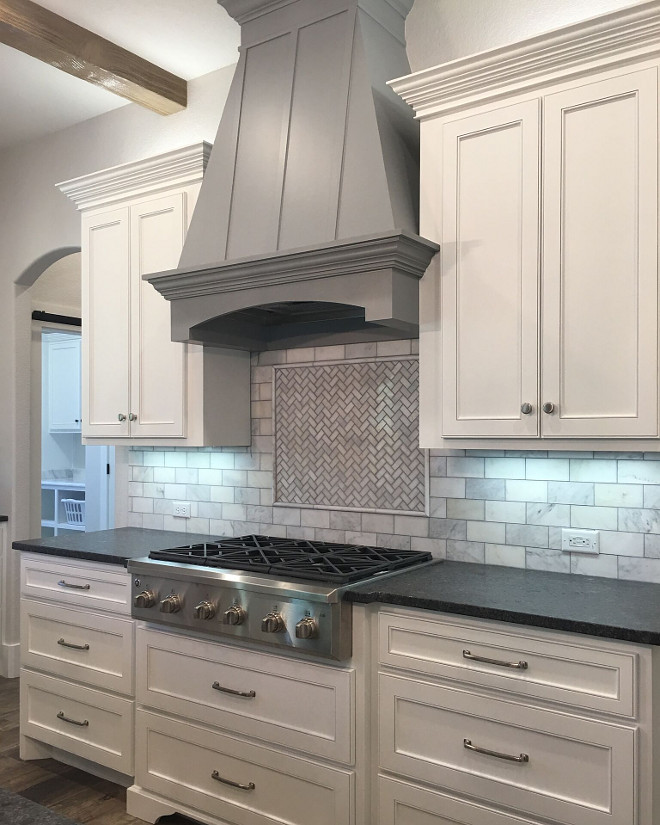 White Kitchen with Grey Hood Paint Color. White Kitchen with Grey Hood Paint Color: White cabinets paint color is Sherwin Williams Extra White. Grey hood paint color is Behr Gateway Grey. White Kitchen with Grey Hood Paint Color. #WhiteKitchen #GreyHood #PaintColor #sherwinwilliamsextrawhite #behrgatewaygrey white-kitchen-with-grey-hood-paint-color Instagram Newly Built Home Ideas Instagram @smithteam6