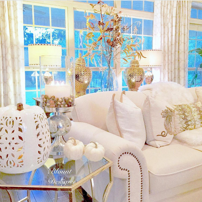 White & Gold Fall Decor: White pierced ceramic pumpkin, Demijohn: Pottery Barn - Sofa: Joss and Main - Gold pierced Ginger Jars: Zgallerie - Side table, Sequined lumbar pillows, Pumpkin Pillows: HomeGoods white-and-gold-fall-decor Home Bunch Beautiful Homes of Instagram @blountdesigns