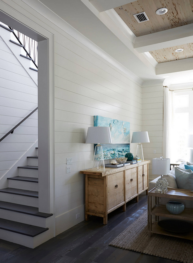 I love the contrast the dark hardwood flooring creates against the white shiplap walls. white-shiplap-walls-with-dark-stained-floors Geoff Chick & Associates