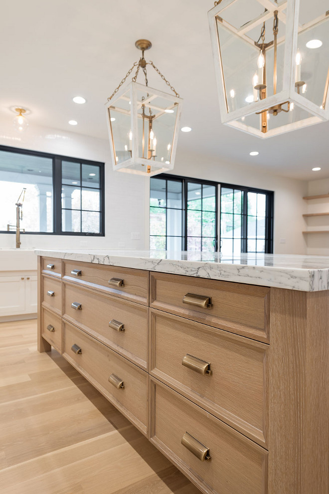 White oak rifted and quarted kitchen island. White oak rifted and quarted kitchen island and white oak flooring. #Whiteoak #Whiteoakisland #rifted #quarted #cabinet #kitchenisland white-oak-rifted-and-quartered-kitchen-island Caitlin Creer Interiors & @mariannebrown12. Northstar Builders, Inc. Photo by @lucycall.